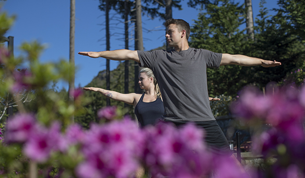 Couple doing yoga at Bear Moutain